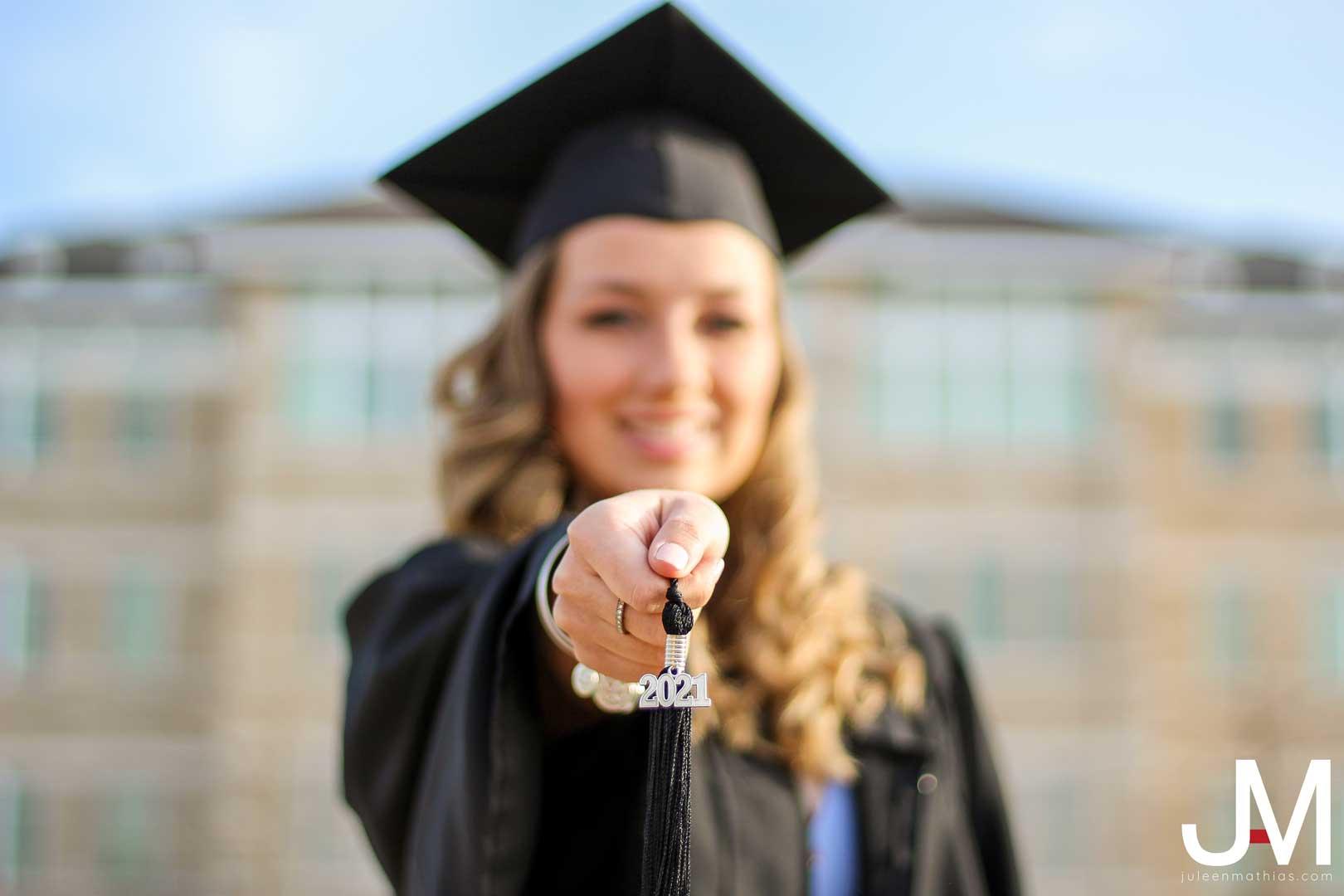 graduate blowing confetti